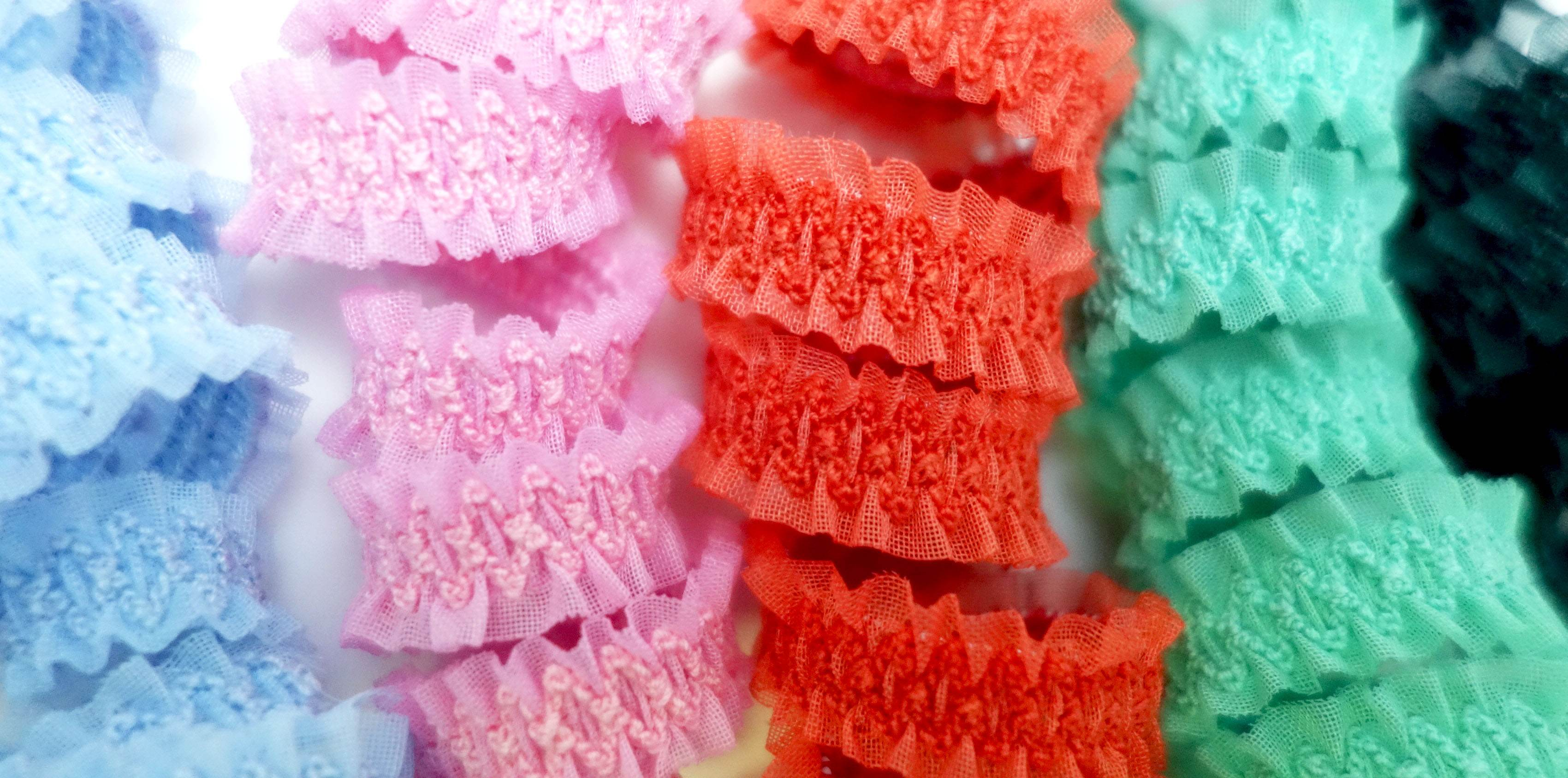 Ruffled organza ribbons with embroidered elastic band