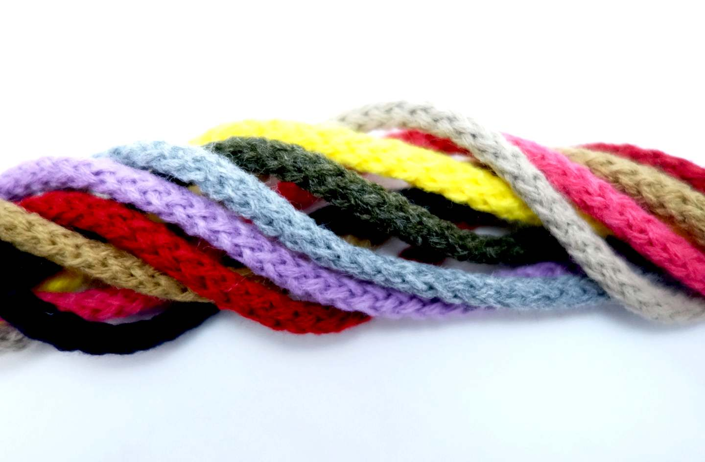 Textile fashion cord with pompom